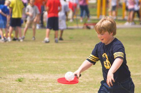 A boy playing a game at field day. 版權商用圖片