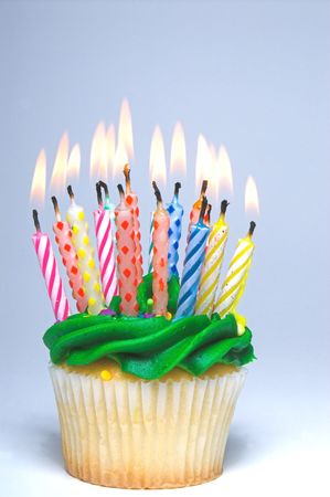happy occasion: A cupcake covered in colorful birthday candles. Stock Photo