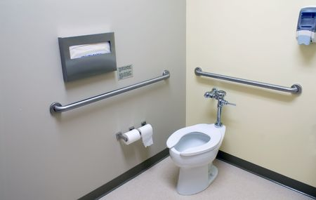 latrine: The inside of a large handicap acesable bathroom