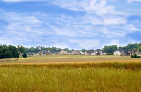 housing development: A new housing develpoment encroaching on farmland.