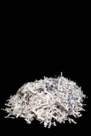 Destroyed documents in a pile from a paper shredder. photo