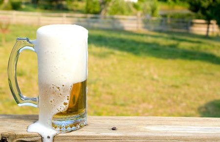 near beer: A glass mug of ice cold beer. Stock Photo