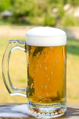 non alcoholic beer: A glass mug of ice cold beer. Stock Photo