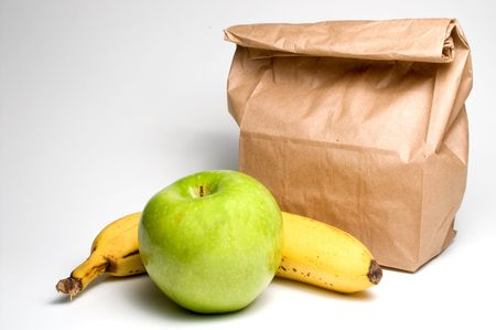 thrifty: Bag lunch with a banana and an apple.