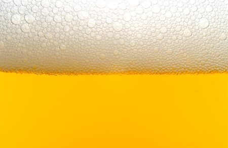 drink responsibly: A close-up image of a beer with a foam head.
