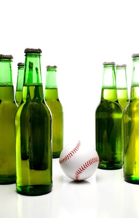 near beer: A baseball and a bottle of beer.