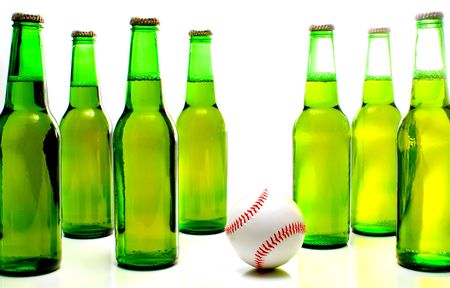 non alcoholic beer: A baseball and a bottle of beer.