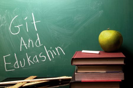 A chalkboard with Git and Edukashin written on it. Stock Photo - 3253354