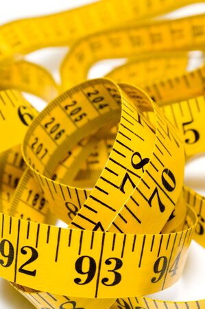 A tailor's measuring tape coiled up randomly. Stock Photo - 3261011