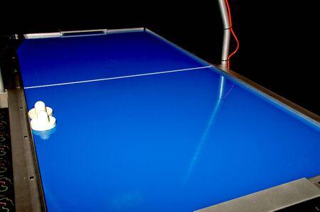 air: An air hockey table in an arcade Stock Photo