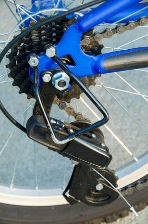 sprockets: A derailleur with sprockets on a mountain bike.