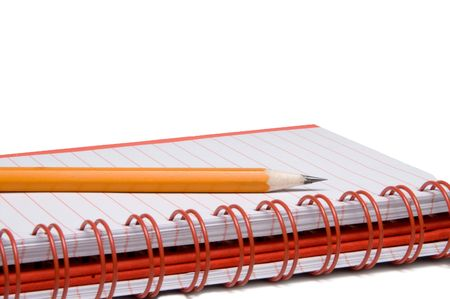 A number 2 pencil and a composition book. photo
