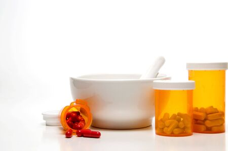 Prescription medicine bottles and a mortar and pestle.