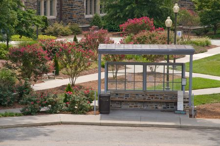 bus stop: An empty bus stop waiting for passengers. Stock Photo
