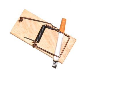 anti tobacco: A cigarette caught in a wooden mousetrap.