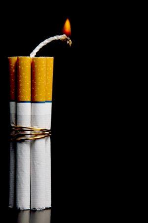 Several cigarettes bound together like sticks of dynamite. photo