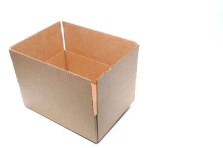 pasteboard: An empty corrugated pasteboard or cardboard box. Stock Photo