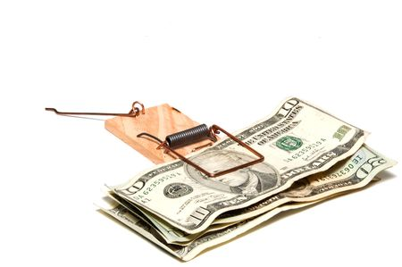 mousetrap: Denominations of merican currency in a mousetrap. Stock Photo