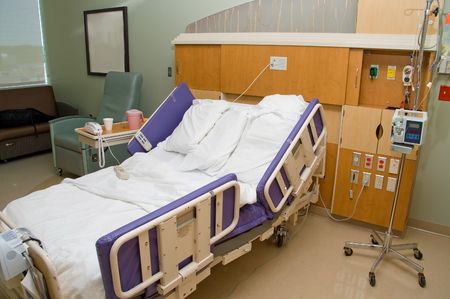 A medical patients bed in a hospital