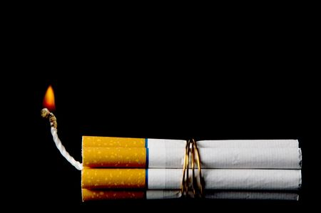 anti tobacco: Several cigarettes bound together like sticks of dynamite.