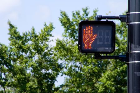A dont walk signal mounted to a street lamp pole. Stock Photo