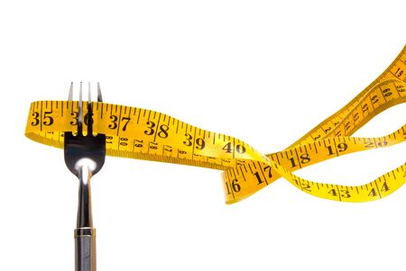 A tailor's measuring tape on a dinner fork. Stock Photo - 3565496