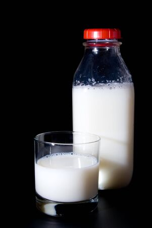 A glass of milk and a milk bottle. Stock Photo - 3579412
