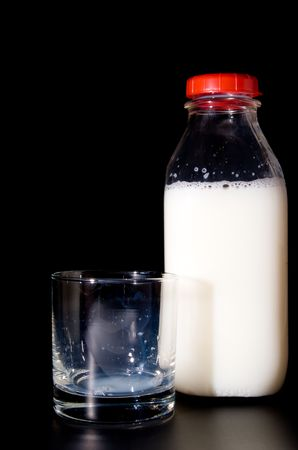 An empty glass and a bottle of milk. Stock Photo - 3579417