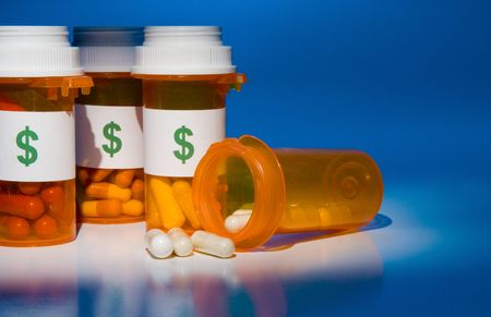 High cost of medication is like pouring money down the drain. Stock Photo - 3588137