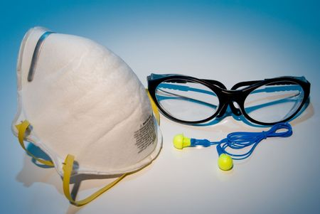 personal protective equipment: Dust mask, ear plugs and safety glasses personal protective equipment. Stock Photo