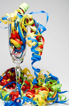 Party time with wine flute and streamers. photo