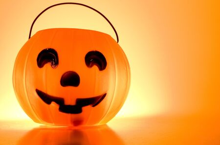 A Jack-O-Lantern trick or treat bucket ready for Halloween. photo