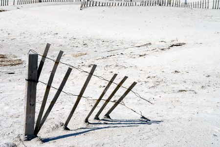 A beach erosion fence in the sand at the ocean. Stock Photo - 3643519