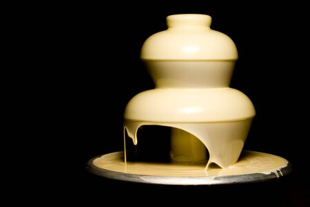 An elegant and gourmet white chocolate fountain.