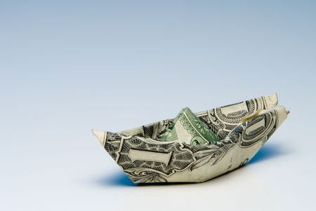 A paper boat made out of a dollar bill. Stock Photo - 3679568