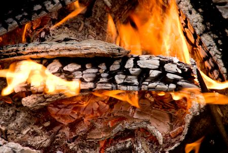 A blazing hot fire at an outdoor campsite. Stock Photo