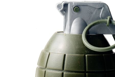 wmd: A military hand grenade ready for action.
