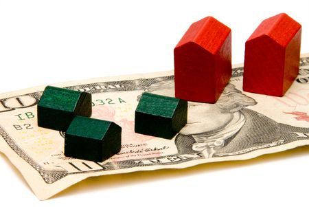 accommodation broker: Houses and hotels built on a cash foundation. Stock Photo