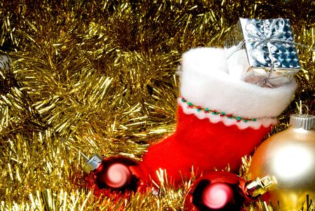 A Christmas stocking filled with holiday goodies. Stock Photo