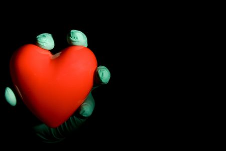 A medical professional holding a red heart. Stock Photo - 3747652