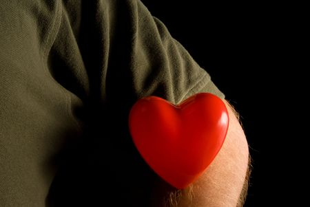 the sleeve: A person wearing their heart on their sleeve. Stock Photo