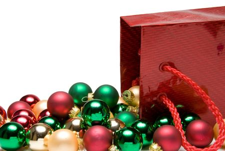 december 25th: A pile of Christmas ornaments in a gift bag Stock Photo