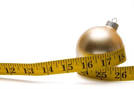 허리의 잘룩 한 선: The concept of dieting during the Christmas holidays. 스톡 사진