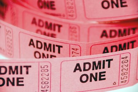 tickets: A small roll of retail admission tickets. Stock Photo