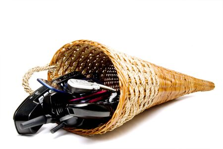 A wicker cornucpia filled with communications equipment. photo