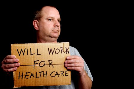 implies: A man holding a sign that implies that he will work for healthcare.