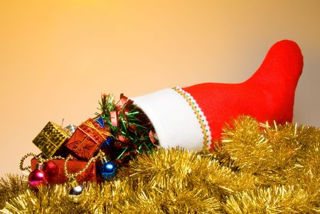 stuffer: A Christmas stocking filled with holiday goodies. Stock Photo
