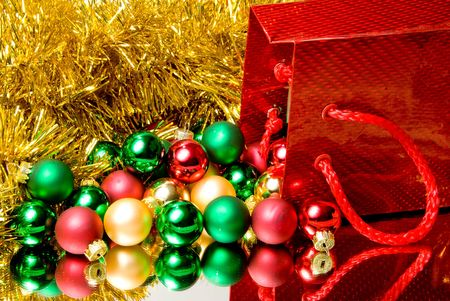 december 25th: A pile of Christmas ornaments in a gift bag. Stock Photo