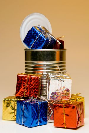 tin can: A tin can overflowing with Christmas presents.