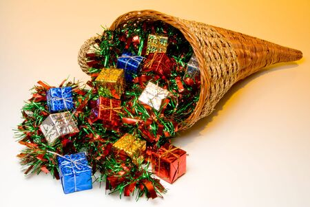 bounty: A cornucopia filled with holidat Christmas presents.